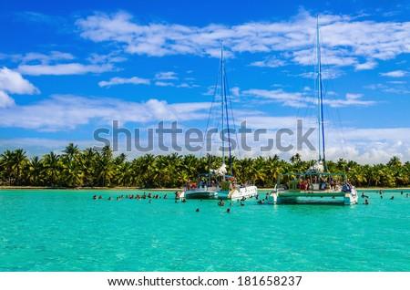 Catamarans on azure water; Caribbean holidays, Caribbean islands - stock photo
