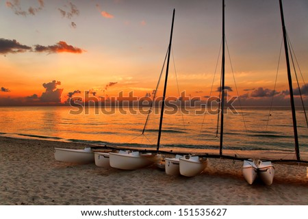 catamarans on Varadero's beach at sunset, Cuba - stock photo