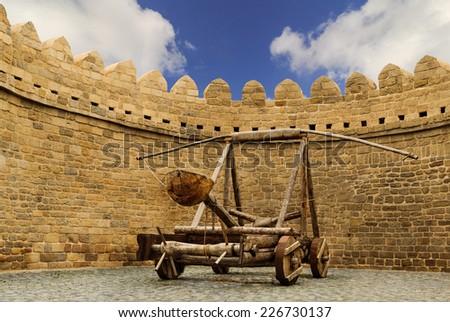 catapult wooden Turkish Mancinik in city wall Icheri Sheher (Old Town) of Baku Azerbaijan - stock photo
