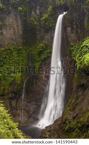 Catarata del Toro waterfall in Costa Rica drops 300 feet into the gorge below. - stock photo