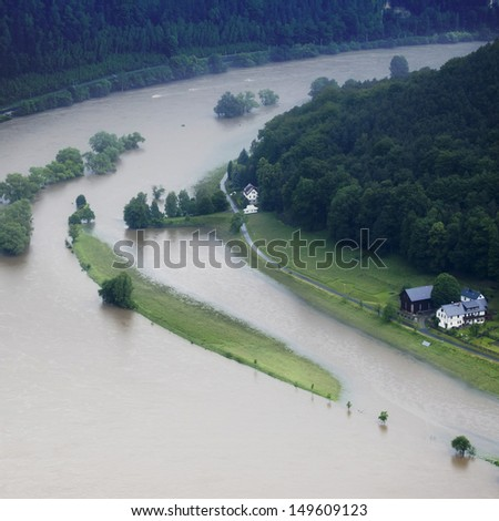 Catastrophic and damaging flood of Elbe river in Germany, houses and streets underwater - stock photo