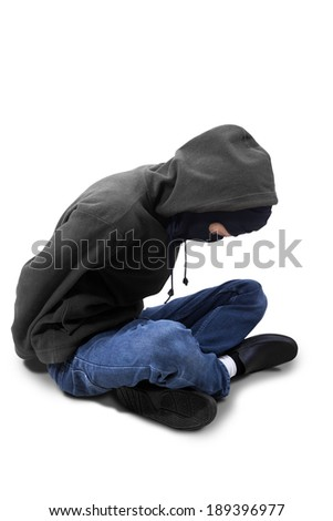 Catch the burglar concept, thief with balaclava caught and sitting on the floor. isolated on white - stock photo