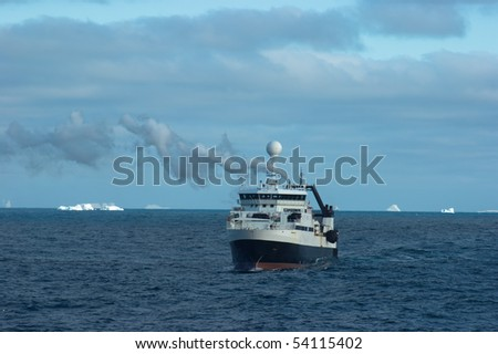 Catcher boat in antarctic area near icebergs Orkney Islands - stock photo