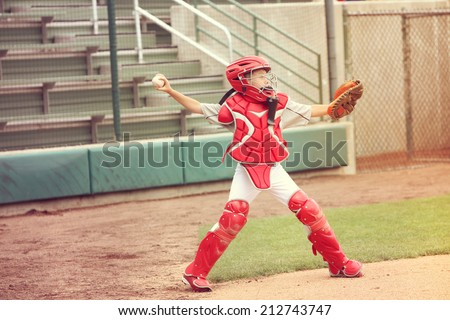 Catcher in baseball throwing the ball - stock photo