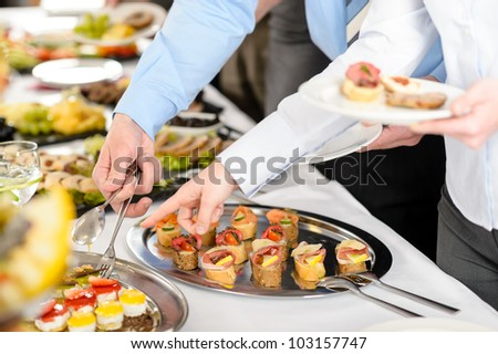 Catering at business company event people choosing buffet food appetizers - stock photo