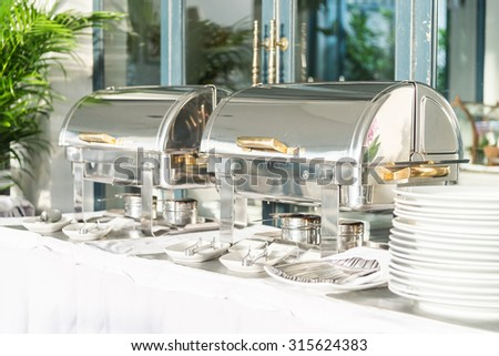 Catering buffet dining in hotel restaurant - stock photo
