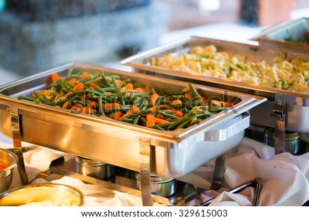 Catering meal at a wedding reception of green beans and carrots. - stock photo