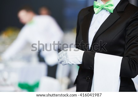 Catering service. waitress on duty in restaurant - stock photo