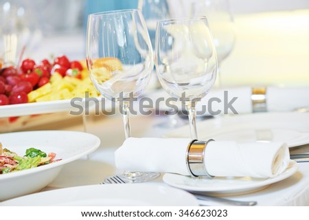 Catering services. glasses set and dish with food meal in restaurant - stock photo