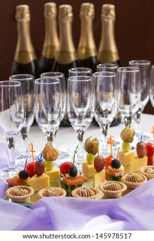 catering serving buffet with canapes and champagne - stock photo