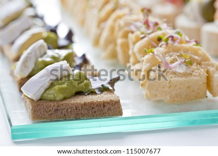 catering snacks, appetizers or finger food - stock photo