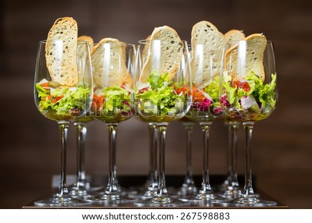 catering weddings table with wine glasses - stock photo