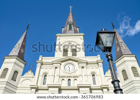 Cathedral and Blue Sky - Clean white cathedral church against deep blue sky. - stock photo