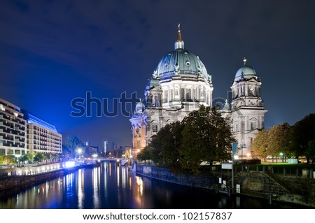 cathedral (berliner dom) and Spree river in Berlin at night - stock photo