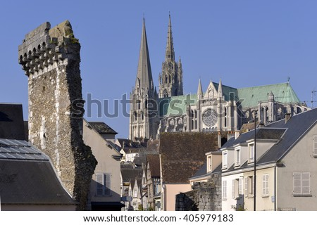 Cathedral Notre-Dame of Chartres with old vestige of the Porte Guillaume. Chartres is a commune and capital of the Eure-et-Loir department in region Centre-Val de Loire in France.  - stock photo