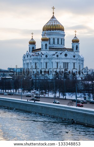 Cathedral of Christ the Savior and Moscow river at winter sunset against the background of cloudy sky - stock photo