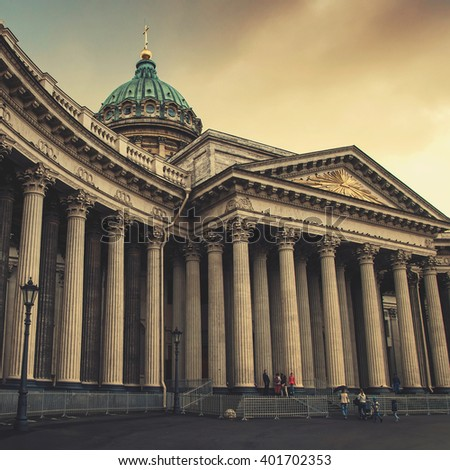 Cathedral of Our Lady of Kazan, Russian Orthodox Church in Saint Petersburg, Russia. Cloudy weather and people - stock photo