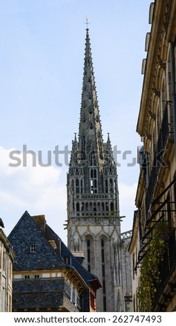 Cathedral of Quimper seen through the narrow street. Brittany, France. - stock photo