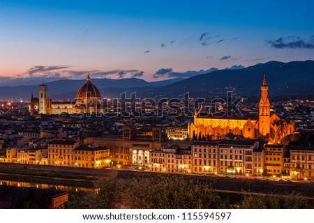 Cathedral of Santa Maria del Fiore (Duomo) and basilica of Santa Maria Novella at night, Florence, Italy - stock photo