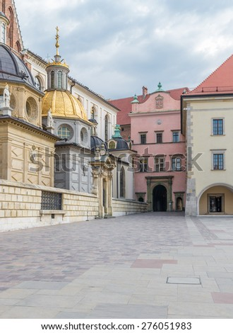 Cathedral of St Stanislaw and St Vaclav and main gate to the Royal Palace on the Wawel Hill, Krakow, Poland. - stock photo