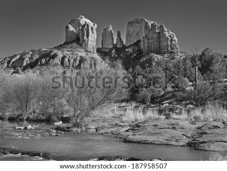 Cathedral Rock in Coconino National Forest in Arizona photographed from Crescent  Moon Ranch State Park on Oak Creek in winter photographed in Black and White. - stock photo