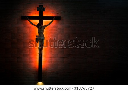Catholic Christian Crucifix in silhouette flushed left - stock photo