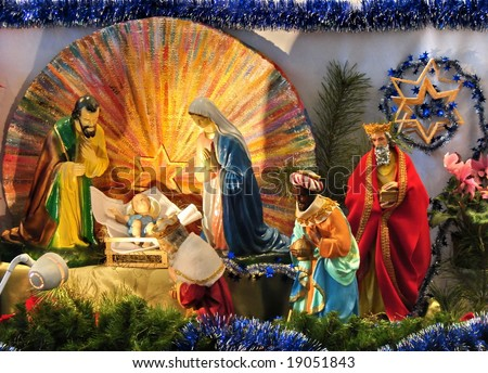 catholic christmas scene with gospel biblical statues - stock photo
