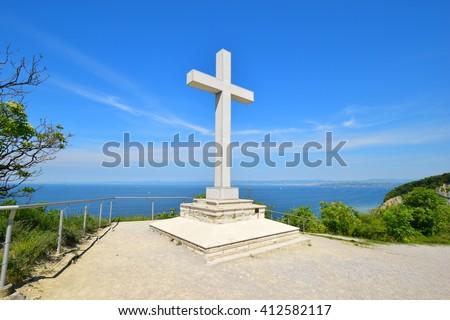 Catholic cross. The Christian cross on the mountain over the sea. - stock photo