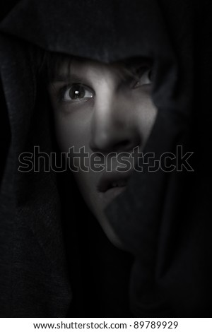Catholic monk in religious hood at night - stock photo