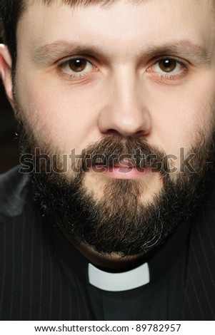 Catholic priest at morning prayer - stock photo