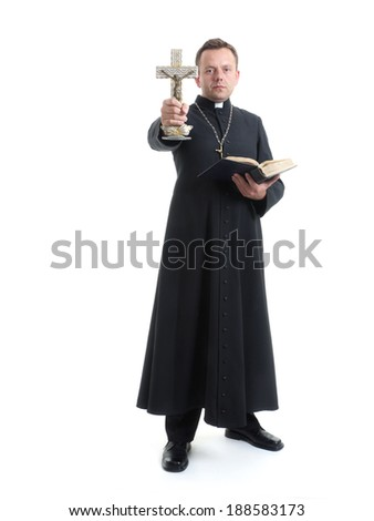 Catholic priest holding Holy Cross and Bible performing exorcisms shot on white - stock photo