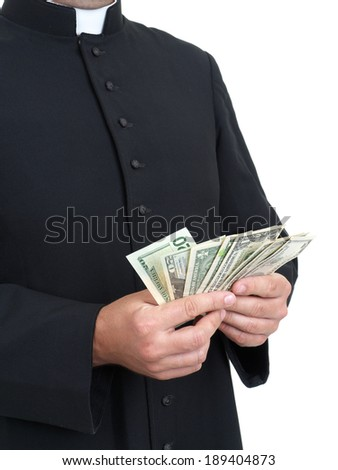Catholic priest with bunch of dollar banknotes - stock photo