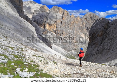 Catinaccio massif with isolated mountaineer above the route to Gardeccia valley, Dolomite Alps, Italy - stock photo