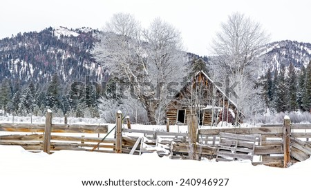 Cattle corral and Barn in winter snow - stock photo