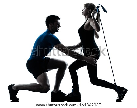 caucasian aerobics instructor  with mature woman exercising gymstick fitness workout in silhouette studio isolated on white background - stock photo