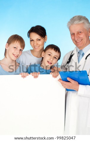 Caucasian aged doctor with a patient on a blue background - stock photo