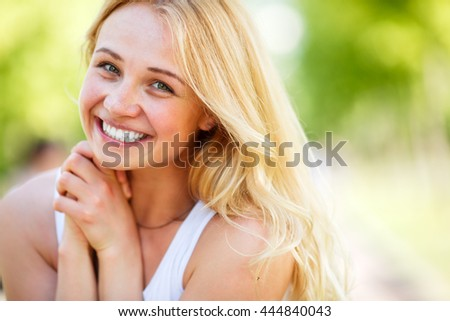 Caucasian attractive smiling blond woman - stock photo