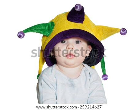 Caucasian baby boy wearing a colored party hat isolated on white - stock photo