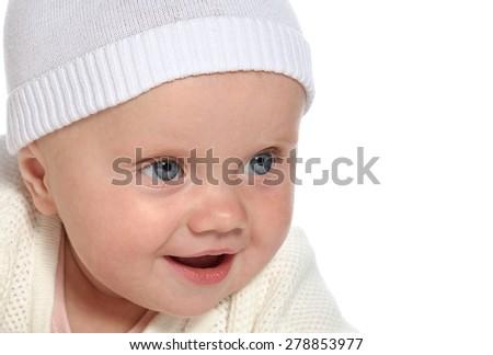 Caucasian baby girl lying down on white blanket smiling  portrait isolated on white  - stock photo