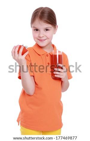 caucasian beautiful little girl drink tasty red tomato juice - stock photo