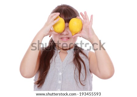 caucasian beautiful little girl with fresh yellow lemons isolated over white background - stock photo
