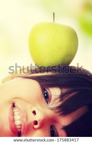 Caucasian beauty with green apple. - stock photo