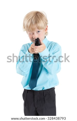 Caucasian blond boy aiming with black gun in hands, isolated on white background - stock photo