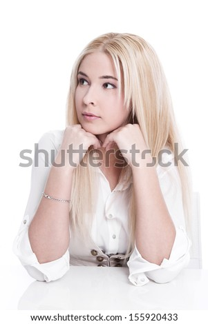 Caucasian blond woman thoughtful and elbowing  - stock photo