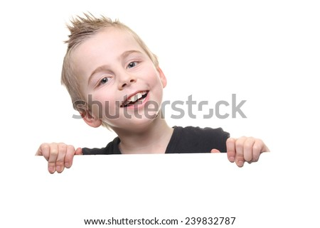 Caucasian boy looking from behind white board - stock photo