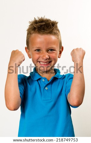 Caucasian boy with raised arms. Studio shot with white background. - stock photo