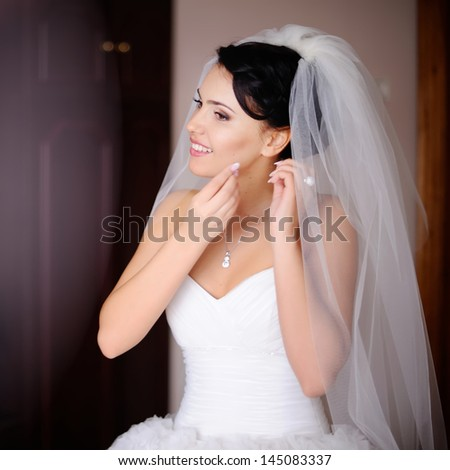 caucasian brunette bride is getting ready in  the morning - stock photo