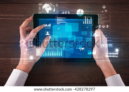 Caucasian business hands holding tablet with blue business-statistics screen - stock photo