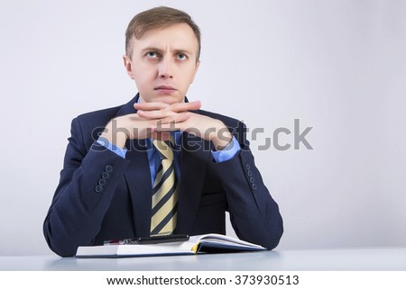 Caucasian business man thinking about business. - stock photo