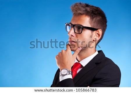 caucasian business man thinking , in pensive behavior on studio blue background - stock photo